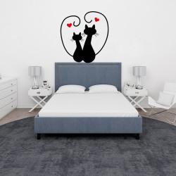 Due gatti con cuori adesivo...